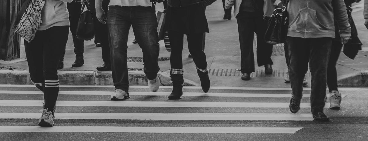 City photo of people walking on a busy crosswalk